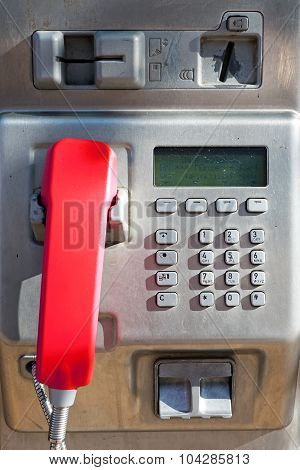 Public Phone With A Red Handset