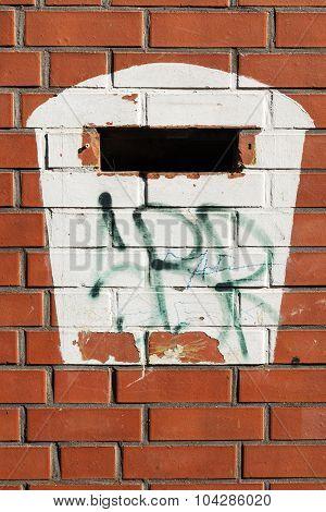 Painted Mailbox At A Red Brick Wall