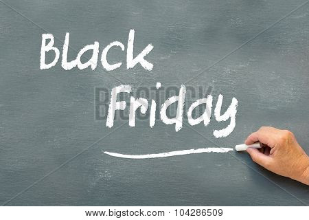 Hand Writing Black Friday With Chalk On A Chalkboard