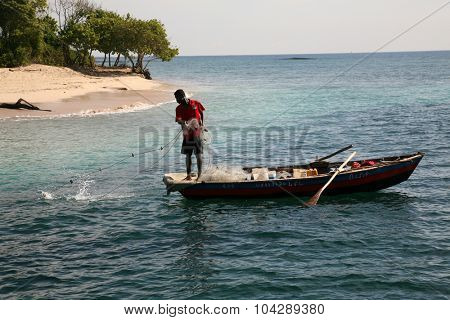 LABADEE, HAITI - SEPTEMBER 27, 2015: Fishermen fishing in their boats in the Western Caribbean Waters of Labadee, Haiti.