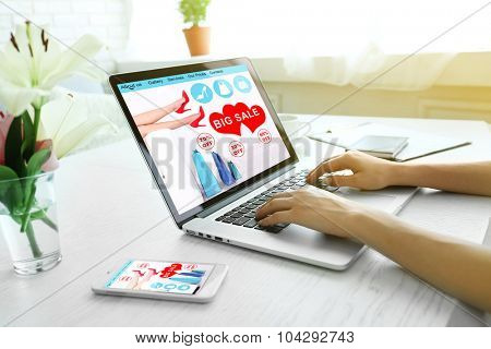 Woman using laptop at workplace. online shopping