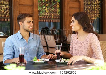 beautiful young couple have dating in cafe