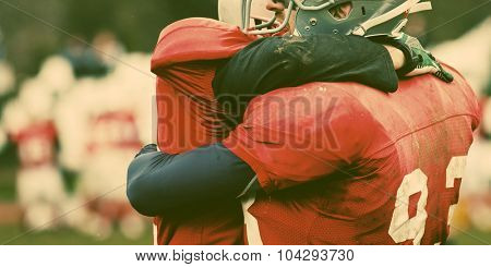 american football game - players hugging on field - retro style