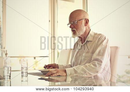 Elderly man eating pasta