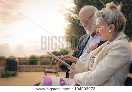 Elderly couple using a tablet