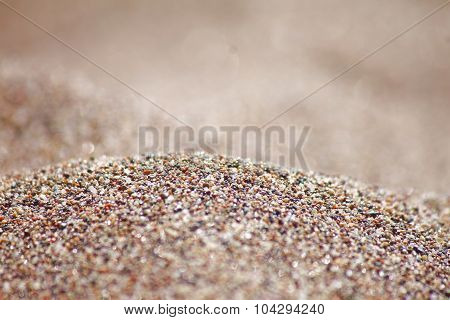 Sea run-multicolored sand on the beach close-up