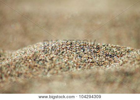 Sea run-multicolored sand on the beach close-up