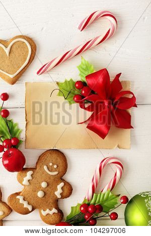 Christmas gift tag with decorative christmas gingerbread cookies and ornaments