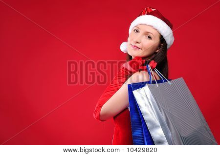 young girl dressed as Santa Claus