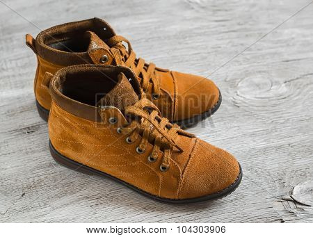 Women's Suede Brown Shoes On A Light Wooden Surface