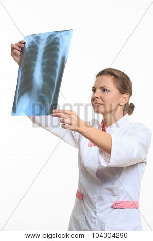 woman doctor holding an x-ray edges
