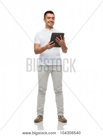 technology and people concept - smiling man with tablet pc computer