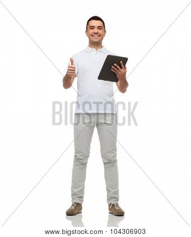 technology, gesture and people concept - smiling man with tablet pc computer showing thumbs up