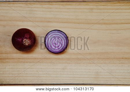 Splitted Red Onion On Wood