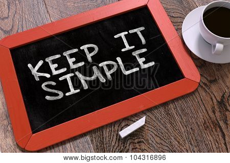 Keep It Simple Handwritten on Chalkboard.