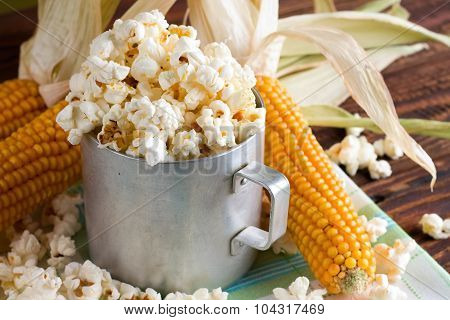 Old Cup With Popcorn And Few Corncobs