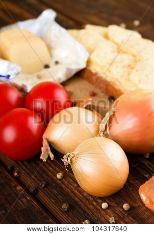 Three Onions And Tomatoes And Bread With Cheese