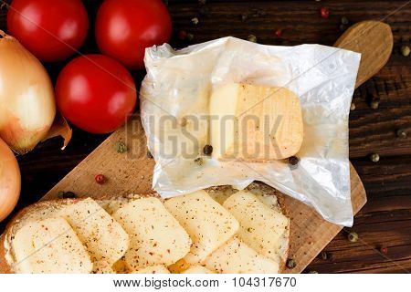 Unpacked Aromatic Romadur Cheese On Chopping Board