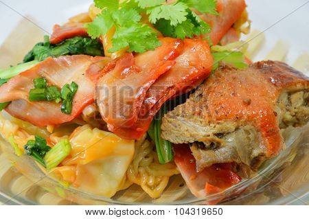 Chinese noodle with barbecue pork and wanton on glass dish