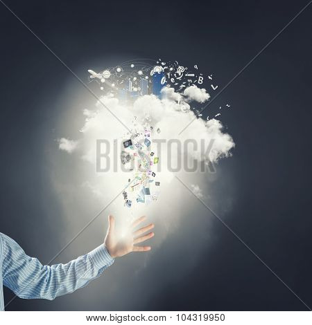 Hand of businessman catching cloud with business icons