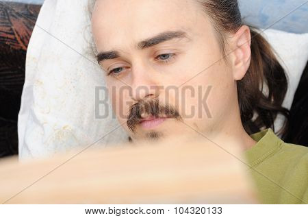Young Man Reading And Falling  Asleep