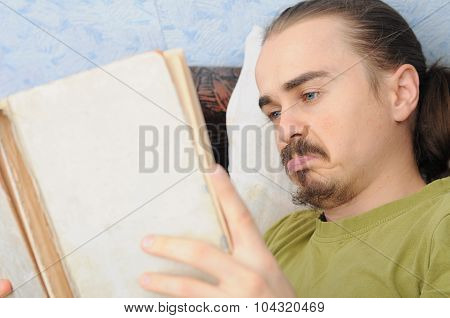 Bewildered Man Reading Book