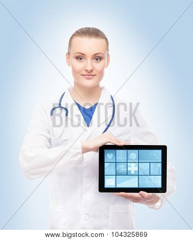 Beautiful and smiling doctor with tablet and great deal of widgets on it. All in one concept.