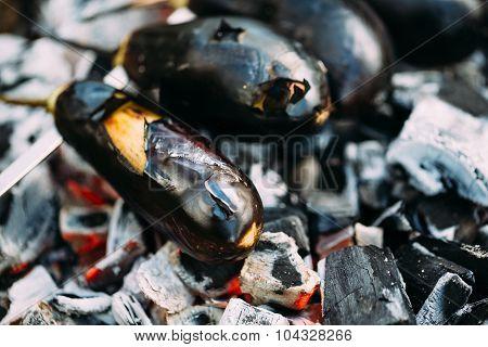 Eggplant on coals closeup.