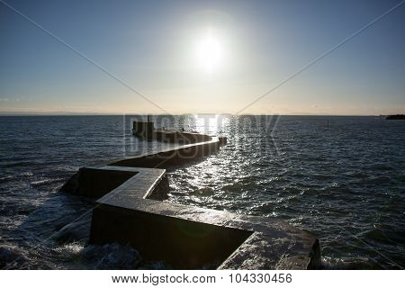 St Monans Harbor Breakwater Coming Up To Sunset, Scotland