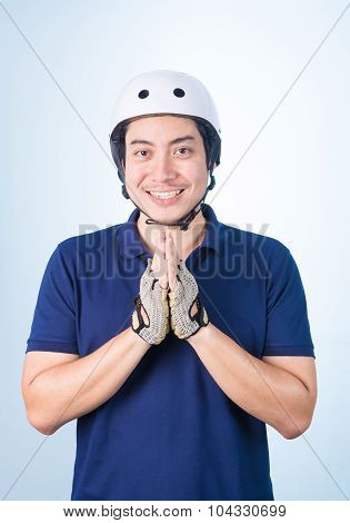 Asian Guy Welcome Greeting Sawasdee With Bicycle Helmet And Gloves,