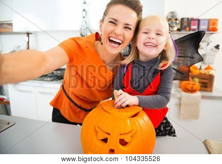 Halloween Dressed Girl And Mother Making Selfie In Kitchen