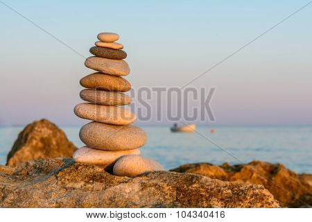 Turret Pebbles At Sunset With Ocean On A Blurry Background. Relaxing Stones.
