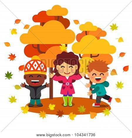 Mixed race kids having fun and playing with leaves