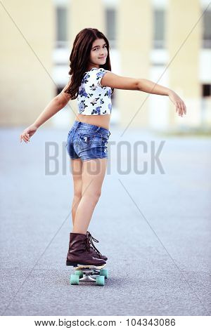 young girl on a skate board