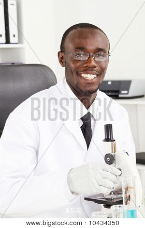 happy african scientist in lab