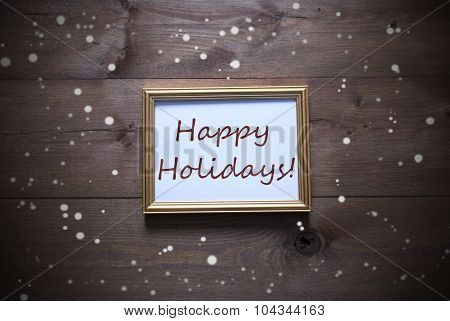 Golden Picture Frame With Happy Holidays And Snowflakes