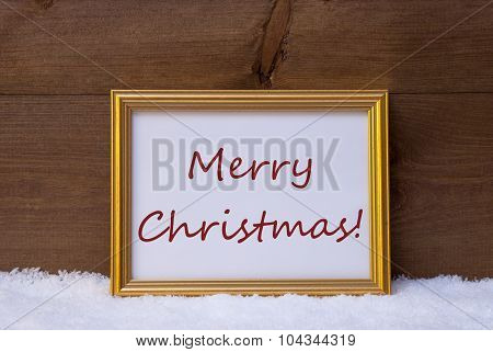 Golden Frame With Red Text Merry Christmas On Snow