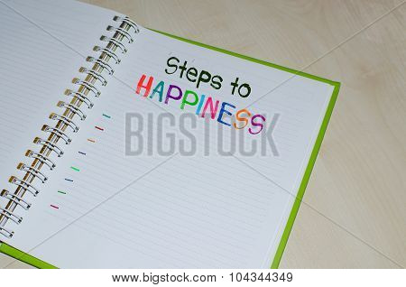 Steps to happiness written on open agenda