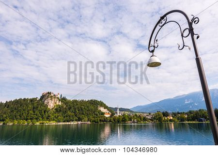 Bled Castle At Bled Lake In Slovenia With Street Lamp