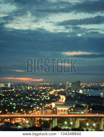 Aerial View Of City Skyline At Twilight. Blur Cityscape Background