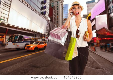 Blond girl tourist shopaholic talking phone in Times Square on New York Manhattan Photomount