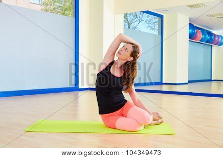 Pilates woman mermaid exercise workout at gym indoor