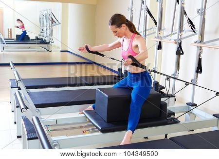 Pilates reformer woman short box horse back exercise workout at gym