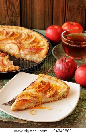 Homemade Apple Tart With Sour Cream With Black Tea And Whole Fresh Apples