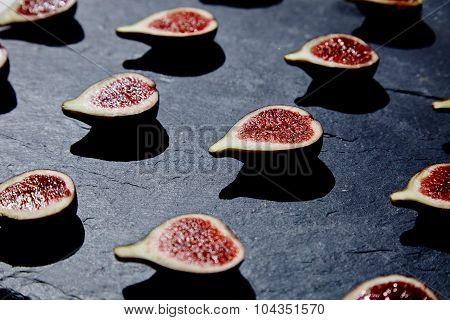 Half Split Figs On Black Stone Side View