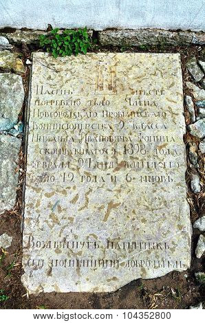VELIKY NOVGOROD RUSSIA - APRIL 30 2015. Ancient headstone cemetery in Anthony's Monastery to Mikhail Ivanovich Fomin -the member of the Novgorod provision commission's office