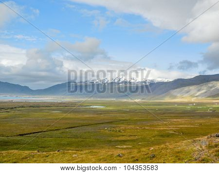 flat Landscape In Iceland with mountains