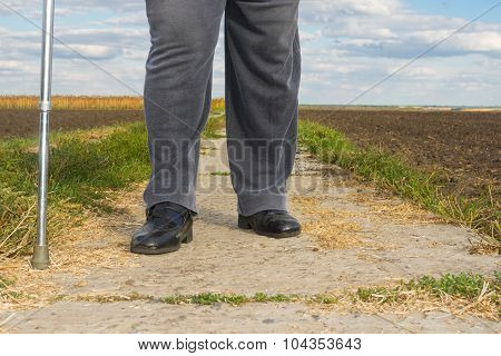 Chubby man with walking stick doing hard step