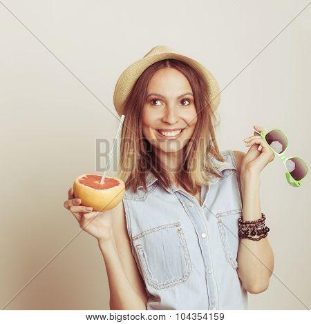 Happy Woman In Hat Drinking Grapefruit Juice. Diet