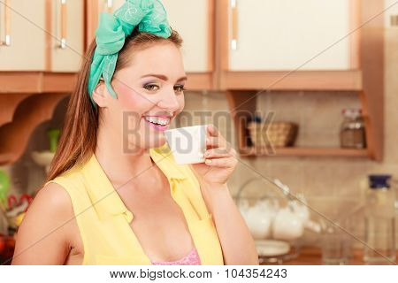 Happy Pin Up Girl Drinking Tea Or Coffee At Home.